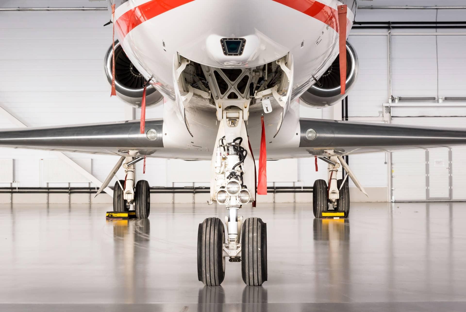 A plane parked inside a garage